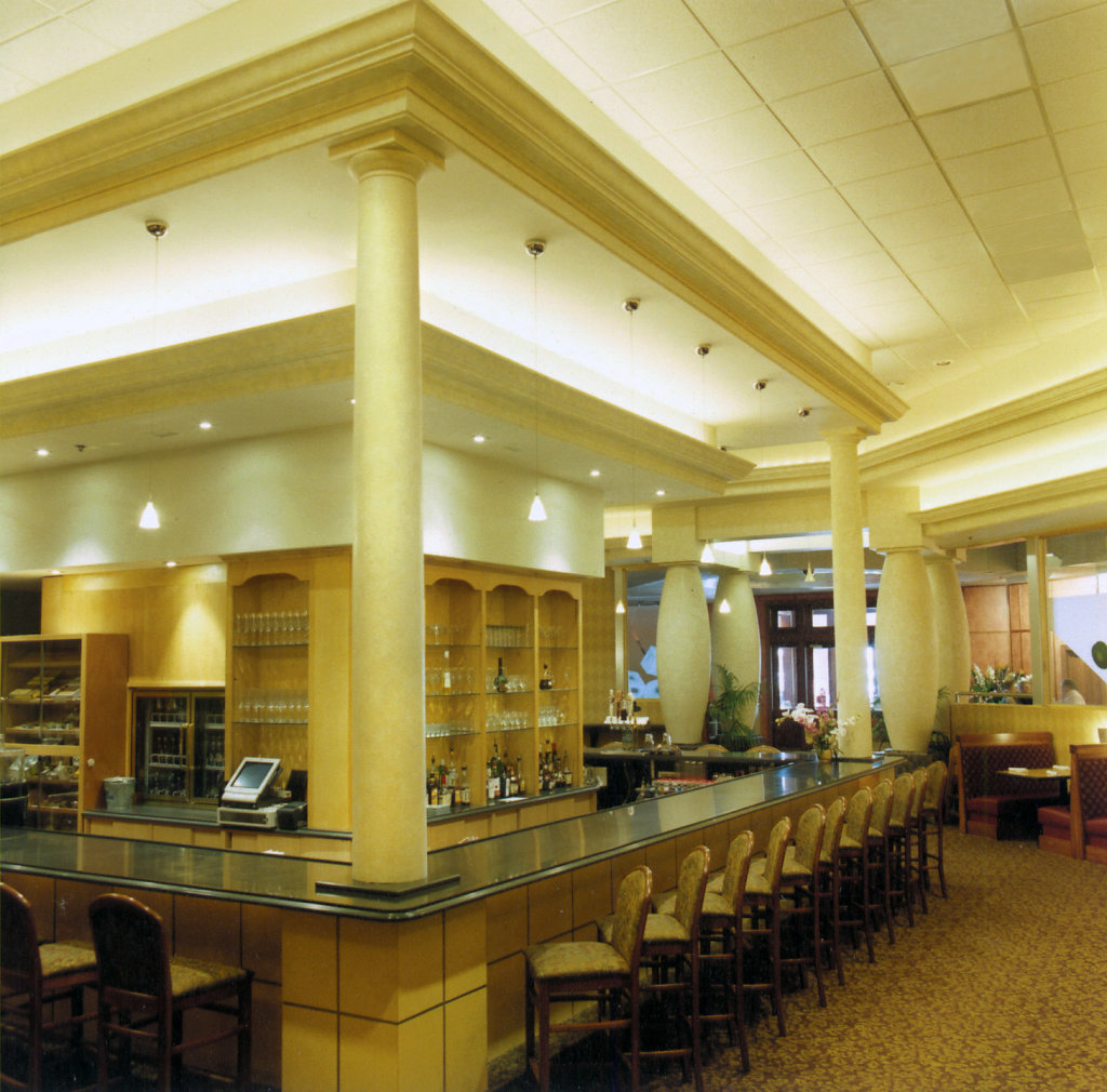 White Greek Doric Wood Columns at a Bar