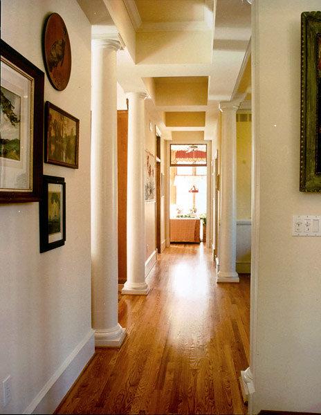 Smooth Tuscan Columns line a Hallway