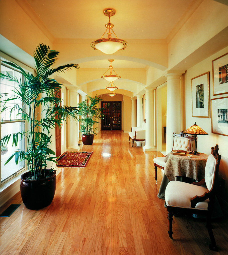 White Tuscan Wood Columns in Foyer