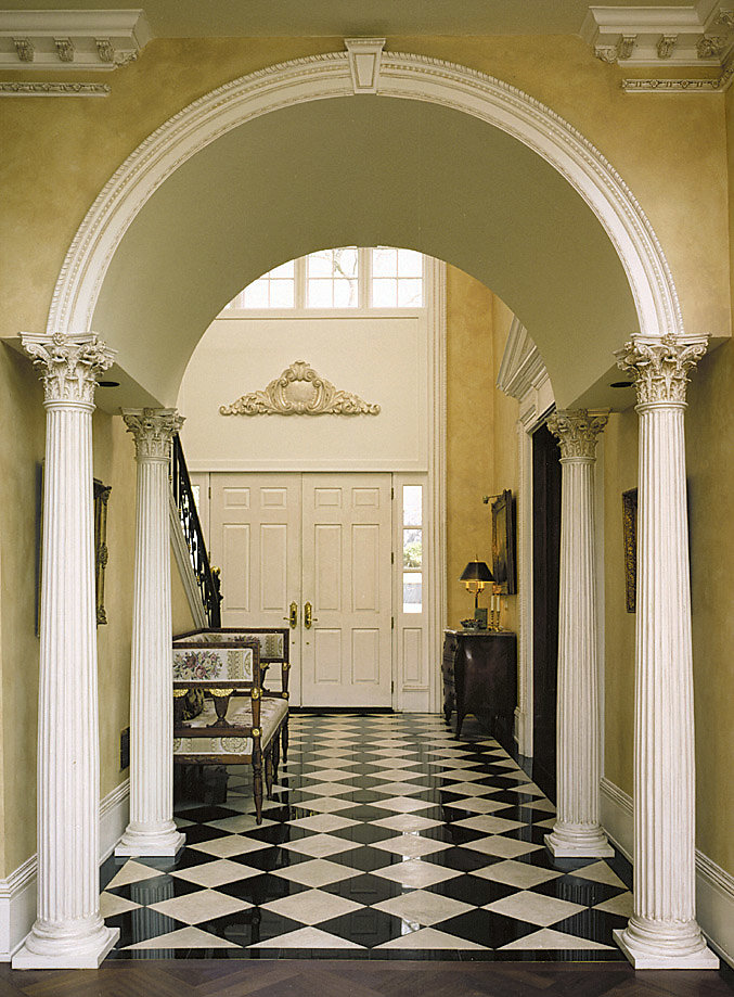 Fluted Corinthian Columns Support an Archway in Foyer