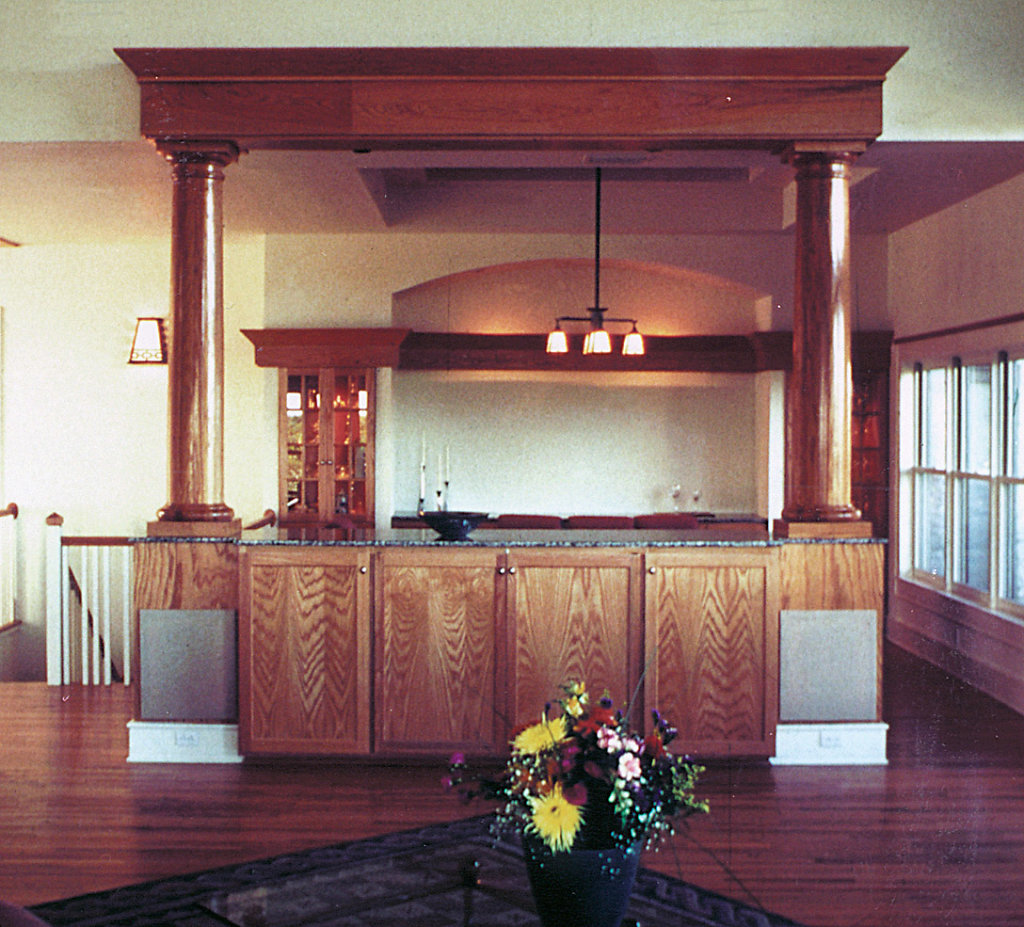 Two Stained Wood Columns on Wet Bar