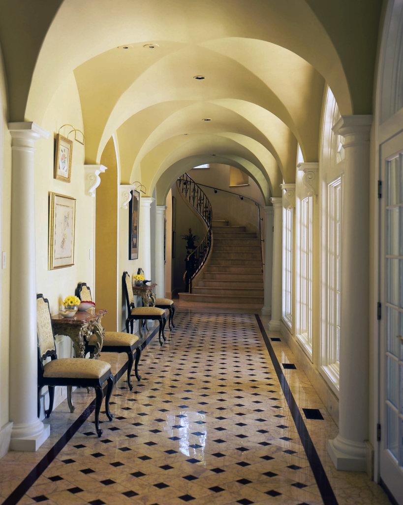 PolyStone® Pilasters Line a Hallway